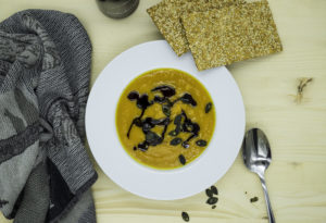 Pumpkin soup with ginger and curry. Healthy fat