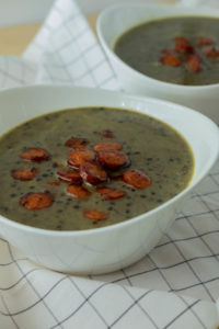 Beluga lentils soup with coconut and fried bio sausage